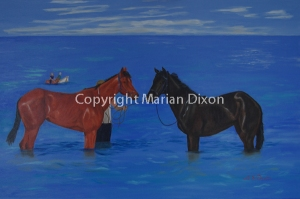 Two Thoroughbreds standing in water at Kwinana Beach