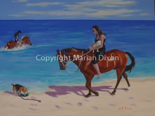 Woman on horseback holding dog on beach