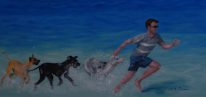 Man running in shallow water with three great danes in pursuit