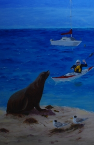 Sea Lion on beach with kayaker approaching